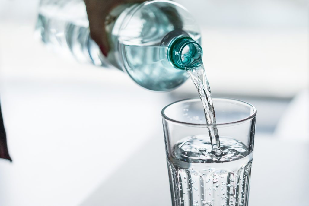 pouring-water-from-pet-bottle-into-a-glass-picjumbo-com